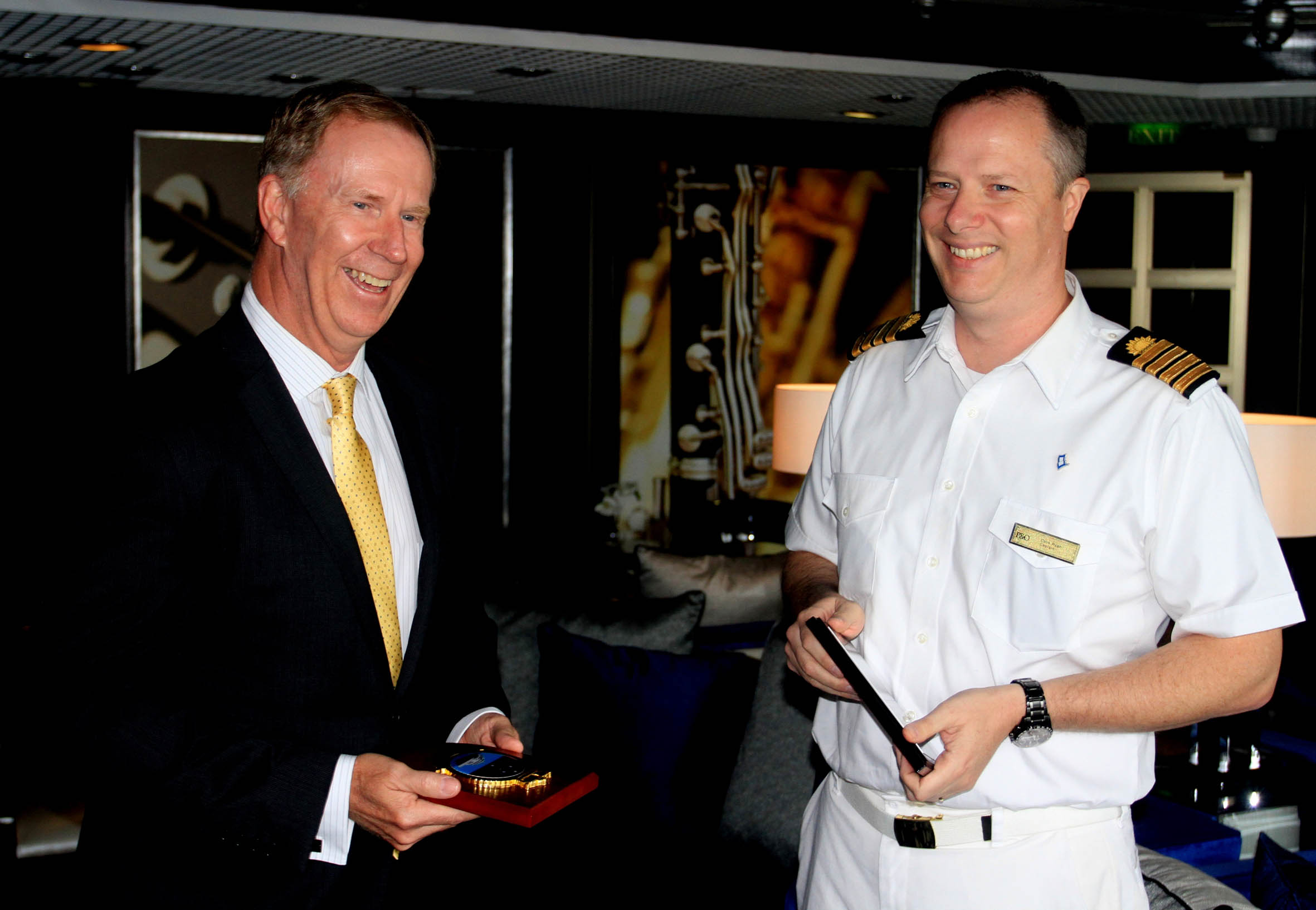 CEO Port of Newcastle Geoff Crowe and Pacific Aria Capt Colm Ryan plaque exchange in Newcastle