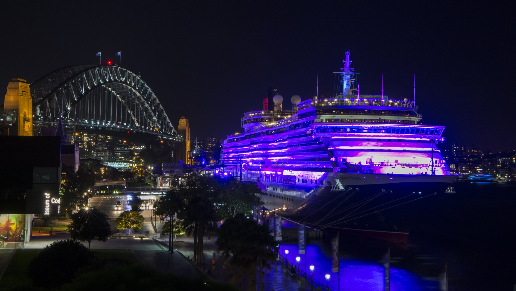 Queen Victoria illuminated in purple at Sydneys Circular Quay for International Womens Day 2016 Credit James Morgan